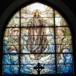 The Ascension Sanctuary Window. All three Sanctuary Windows are Tiffany windows given in memory of Dr. Edson (first rector of St. Anne's), his wife Rebecca, and his daughter, Elizabeth. They were installed in 1909, replacing the original McPhersons which had been given in memory of Dr. Edson alone.