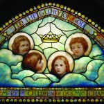 The Cherubs Window, installed in 1908, designed and executed by Tiffany Studio, New York. Given in memory of the three Chambre' children by their father Dr. A. St. John Chambré, second rector of St. Anne's. Note: Extra child's head (in profile) added by the artist for balance.